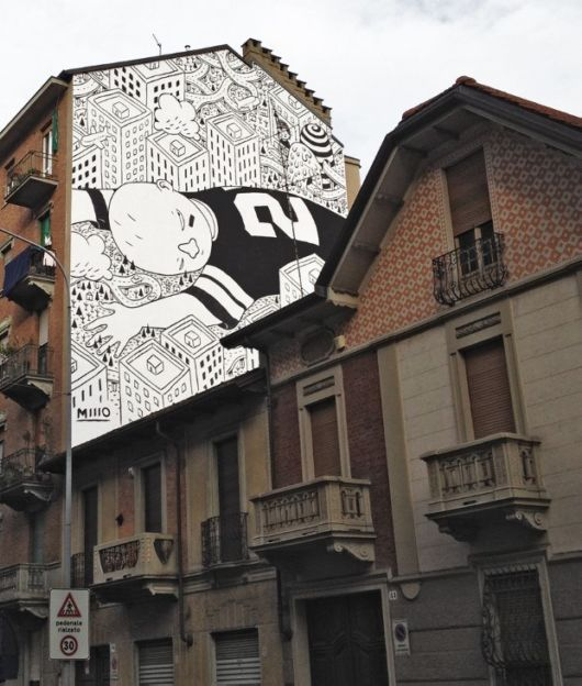 Urban Italian Buildings Covered By Playful Murals